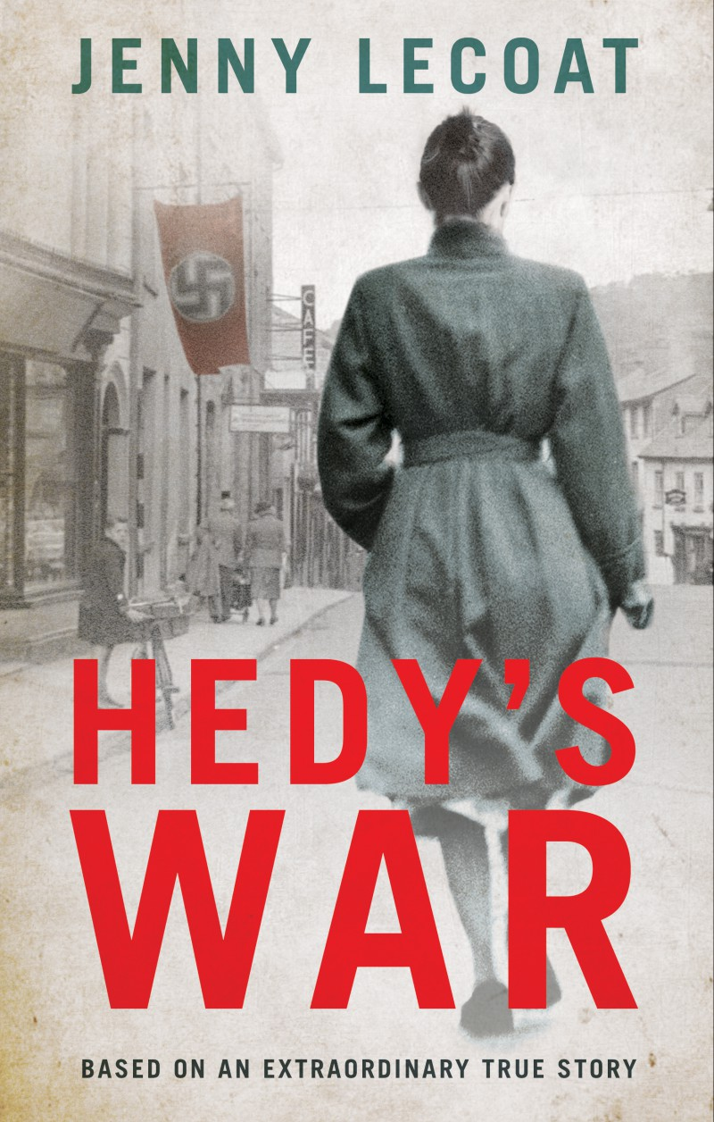 UK book cover, photographic, monochrome image of a woman walking down a 1940s street with a swastika flag hanging from a doorway