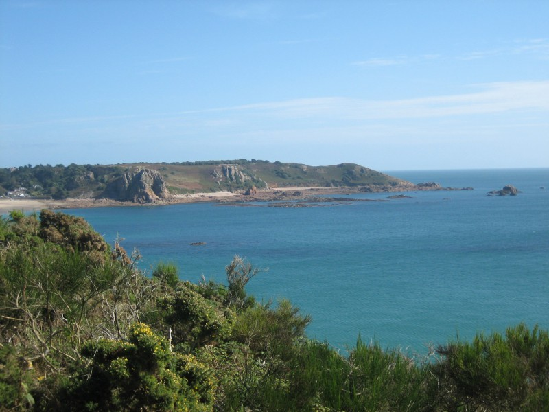 scenic photo of Jersey in the Channel Islands showing the coastline, a headland and the sea